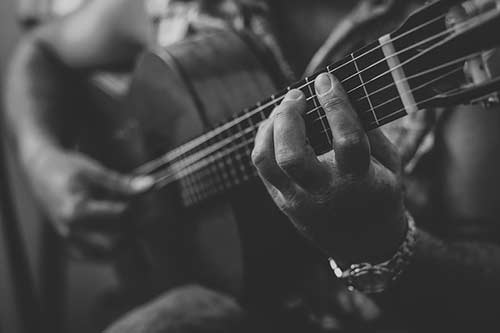 BW Close up of Hands on Acoustic Guitar