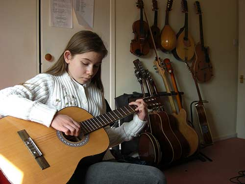 Girl-Playing-Classical-Guitar---1