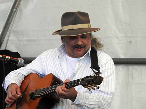 Interesting-Man-with-Hat-Playing-Guitar