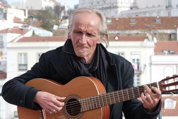Old-Guy-with-Long-Thumbnail-Playing-Acoustic-Guitar-Fingerstyle