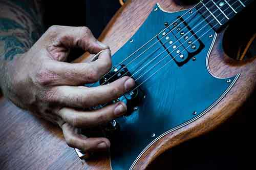 Rough-Hand-Playing-Guitar