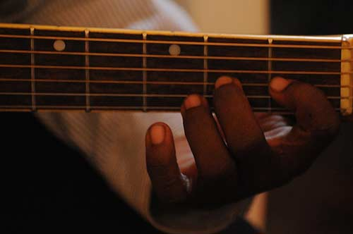 Small-Hands-Playing-Electric-Guitar