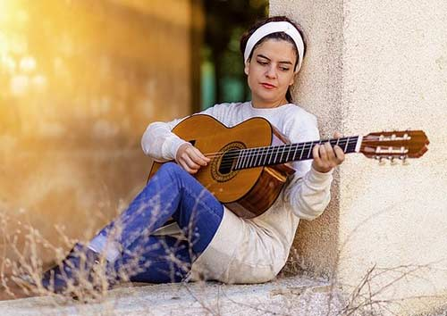 Woman-Playing-A-Classical-Guitar
