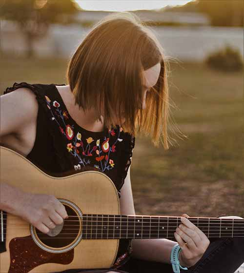 Young-Woman-Playing-Acoustic-Guitar