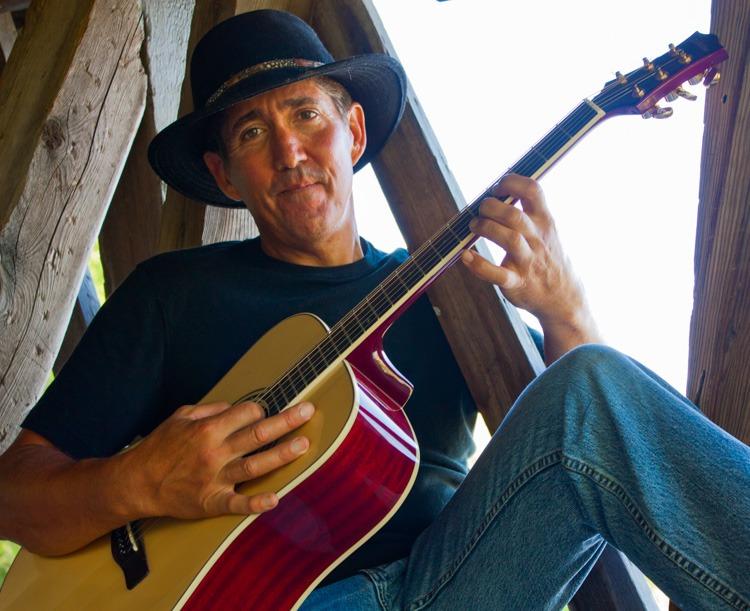 Cowboy Guitarist with Acoustic Guitar
