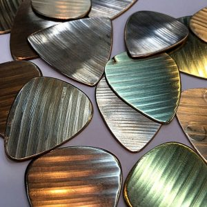 Handmade Guitar Picks from Recycled Cymbals