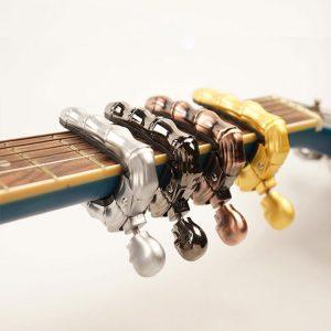 4 Swiveling Skull Bony Finger Guitar Capo